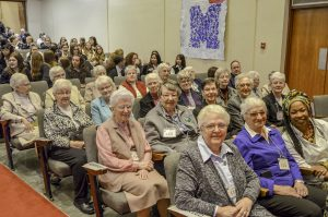 Sisters of the Holy Names and the Grey Nuns attend Mass.